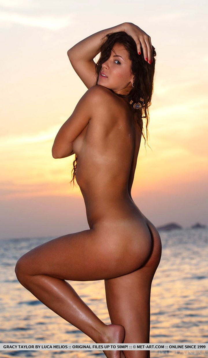 Amazing brunette Gracy Taylor posing naked on beach