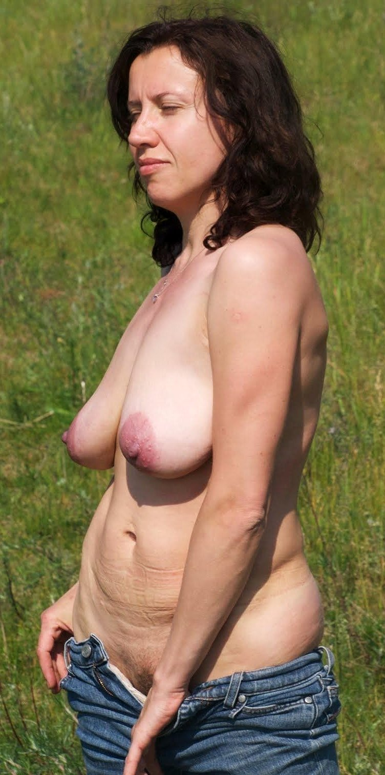 Busty mature woman nude outdoors