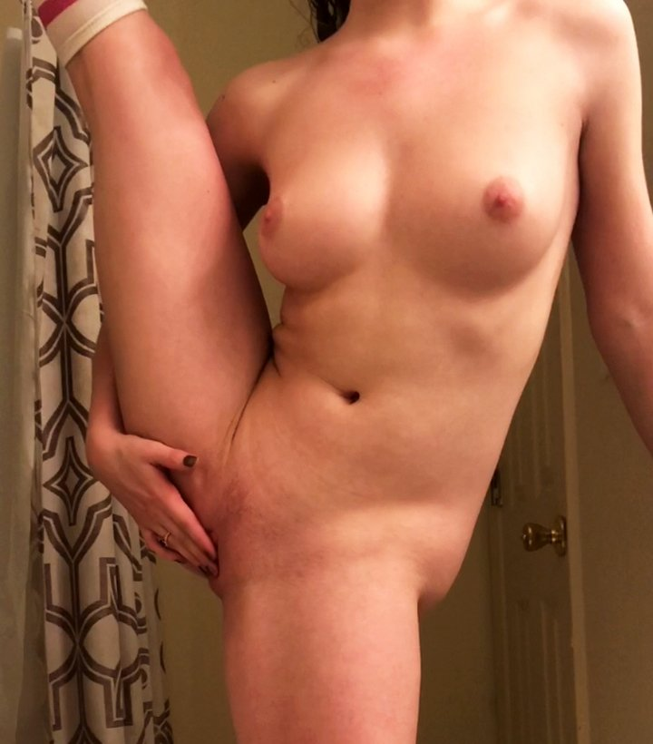 Flexible girl masturbating in front of camera