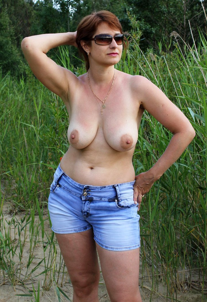 Mature woman with big tits topless outdoors
