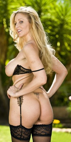 Porn Star with big tits Julia Ann strips outdoors to her black stockings