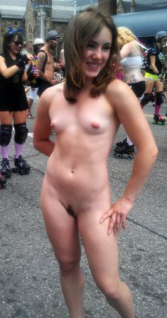 The naughty girl shows off her naked body in public