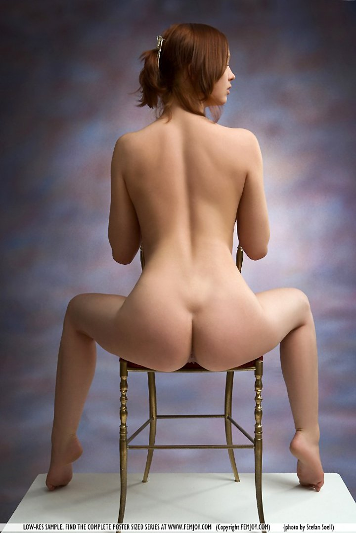Amazing redhead Sylvia naked on gold chair