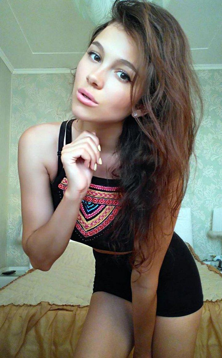 Beautiful webcam model looks at the camera