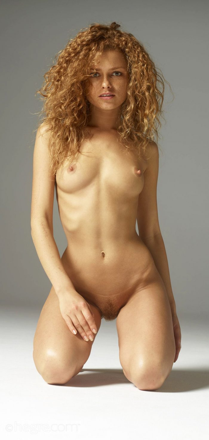 Curly redhead with a slim body Julia posing naked