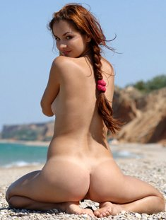 Cute girl Janne nude on the beach