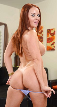 Redhead with big tits Janet Mason shows her perfect body totally naked