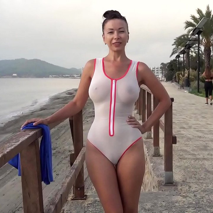 Wet transparent swimsuit in public
