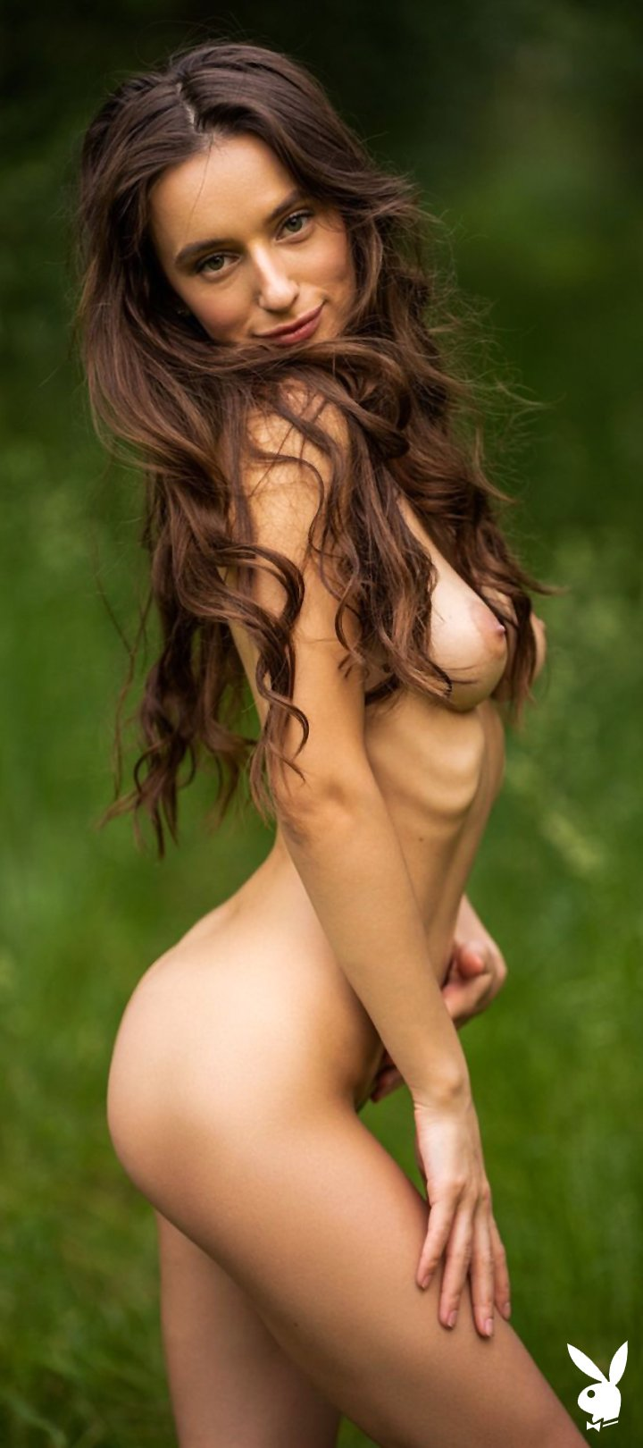 Beautiful brunette Gloria is waiting for you all alone and nude in the woods