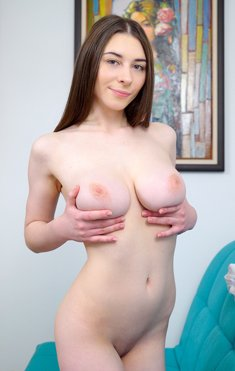 Young cute brunette Clary unleashes her huge natural boobs