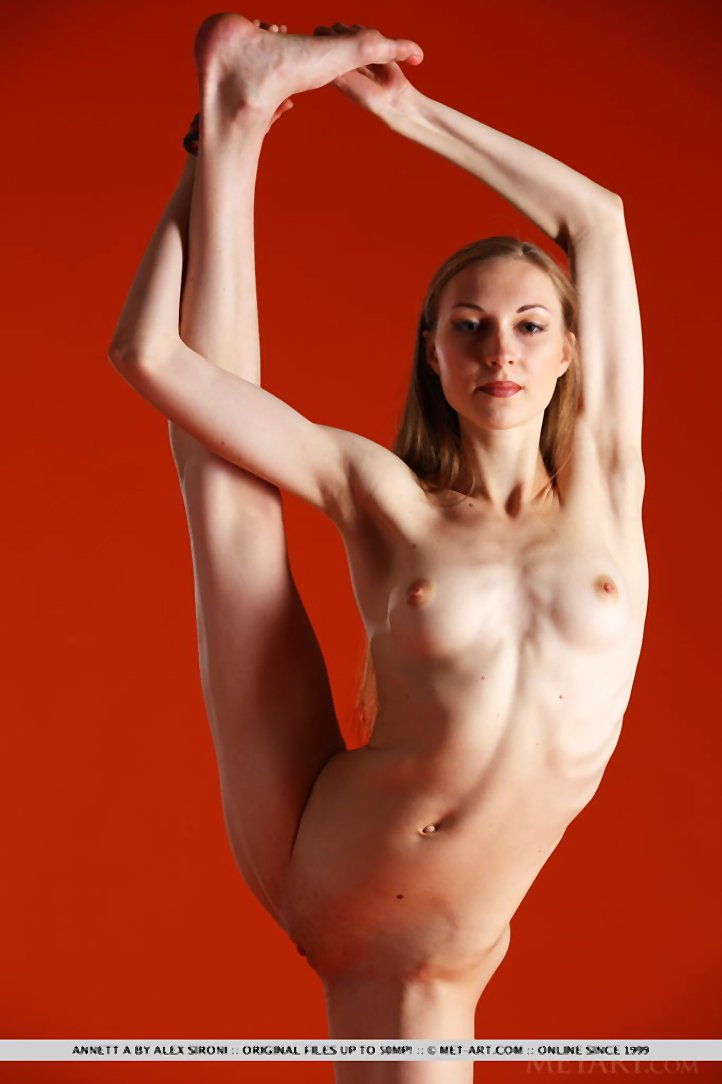 Acrobatic girl Annett A stretches naked with tiny boobs and bald pussy