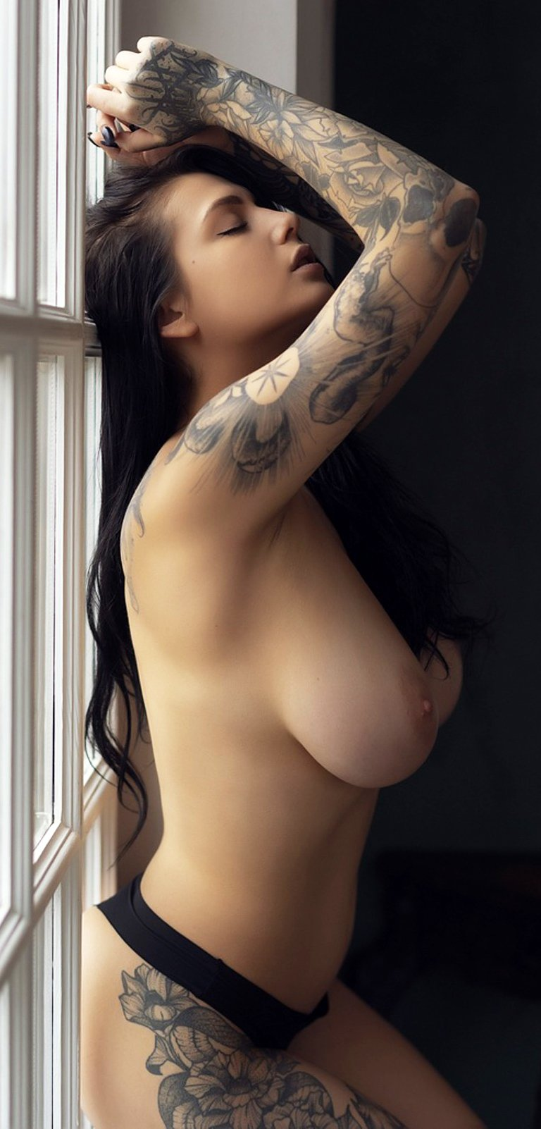 Tattooed brunette wth big tits Evgenia Talanina loves posing for you