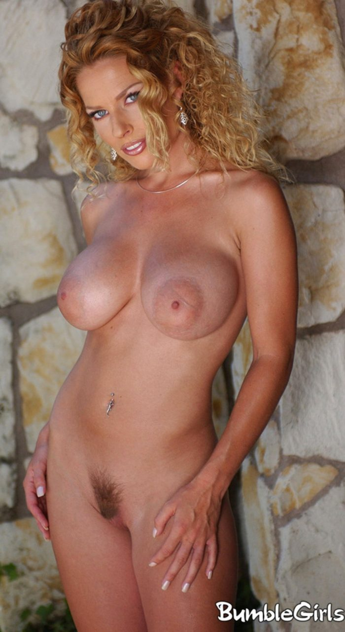 Hot MILF Goldie Jones shows her huge boobs and hairy pussy