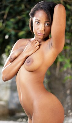 Black girl Ivy Sherwood bares her big tits as she undresses in courtyard