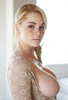 Freckle faced girl Skyla Novea exposing massive boobs