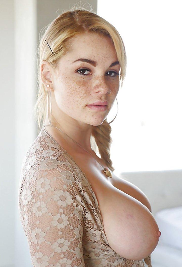 Freckle faced girl Skyla Novea exposing massive boobs