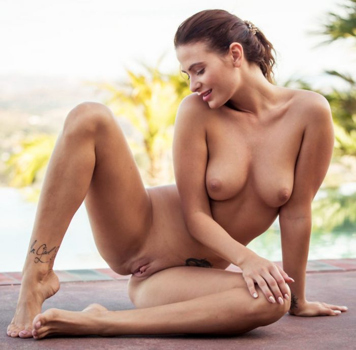 Juliette Cosmo posing in erotic art nudes by the pool