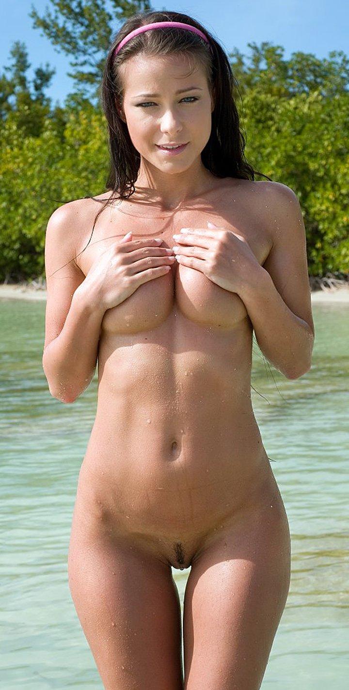 Beautiful brunette Melisa Mendiny takes off her bikini in shallow water