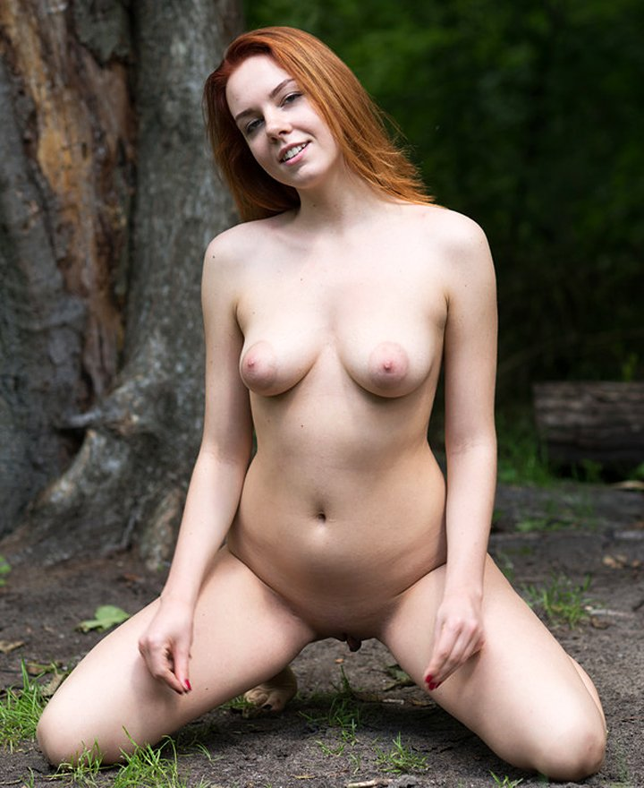 Sexy redhead with big boobs Candy Red naked in nature