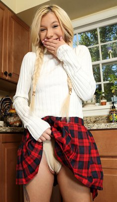 Schoolgirl with pigtails Kenzie Reeves plays with kitchen tools