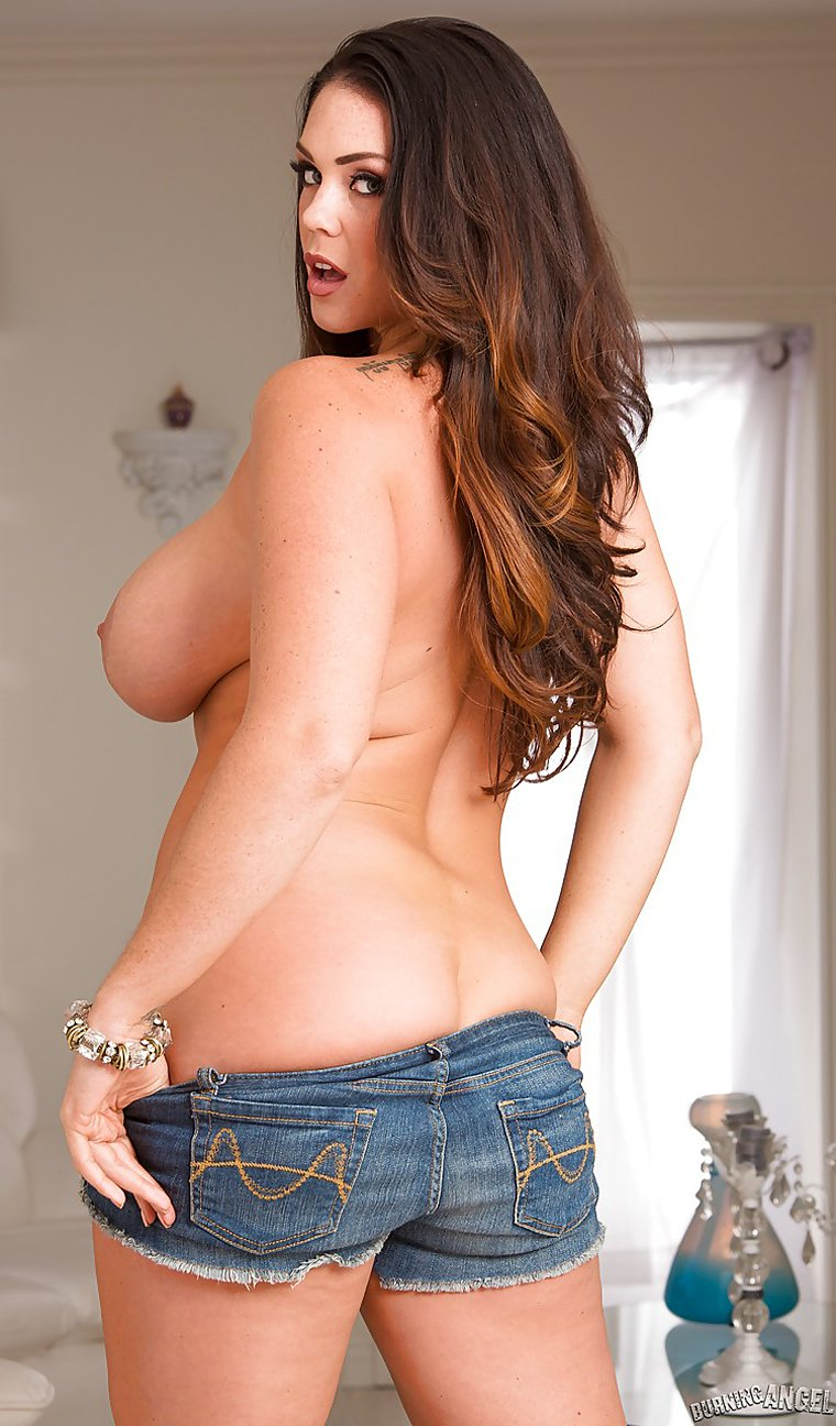 Seductive brunette Alison Tyler showing large boobs and trimmed pussy