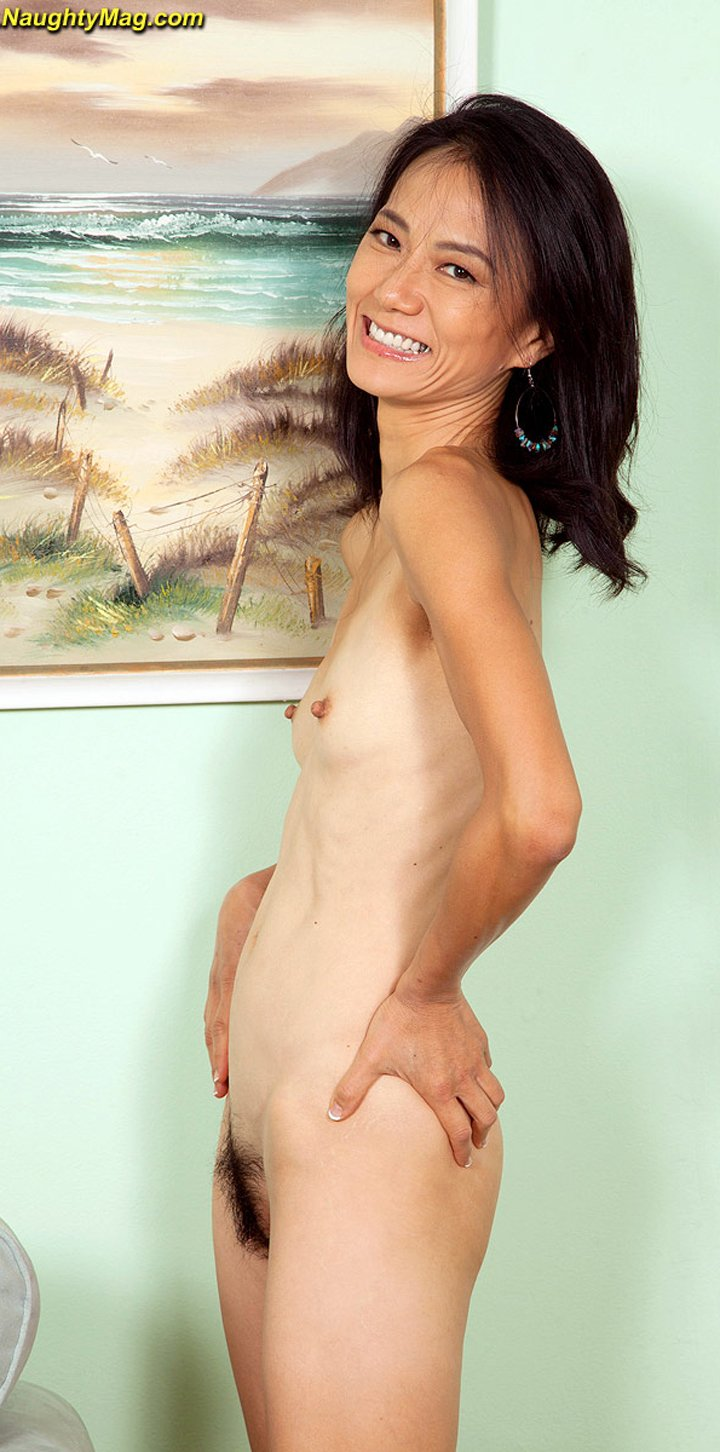 Asian woman Sahara Blue shows off her skinny body and flat chest