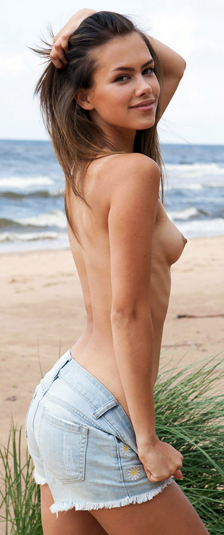 Slim girl Lada A takes off denim shorts to go totally naked at the beach