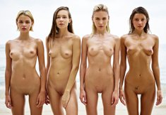 Four beautiful girls show off their naked bodies by the sea