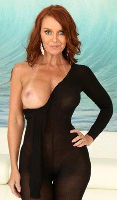 Hot redhead Janet Mason wearing pantyhose & heels getting cum on pussy