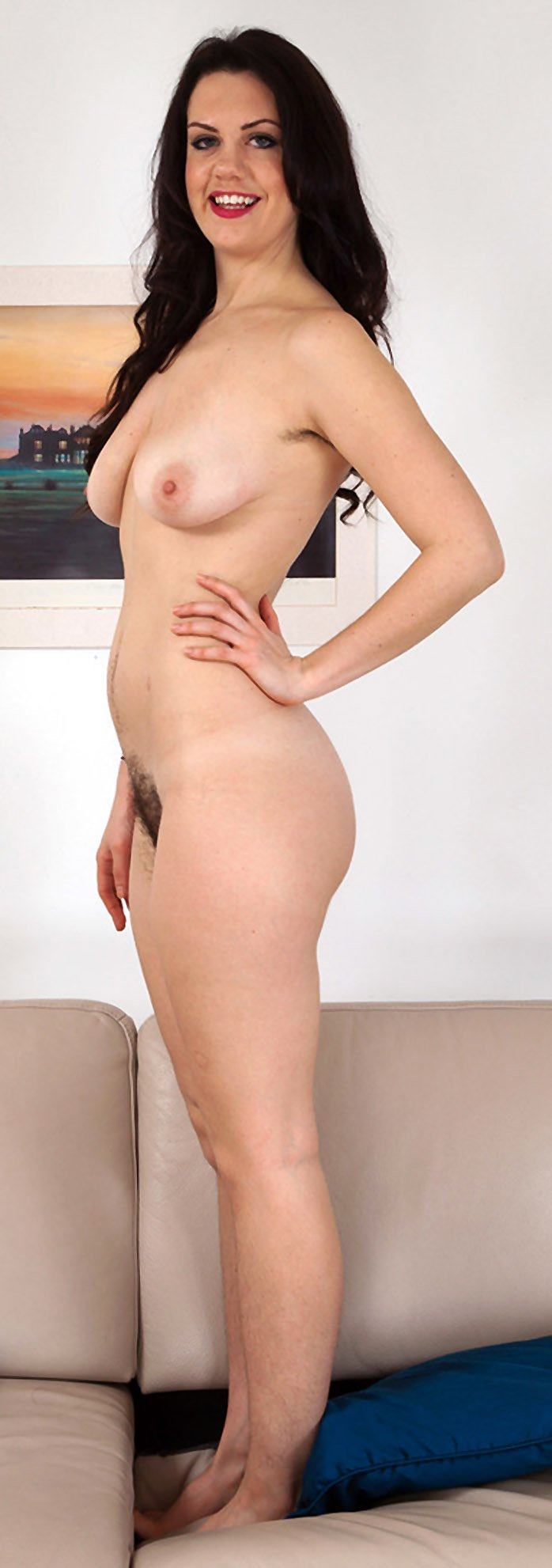 Brunette with hairy pussy Melissa posing naked in the living room